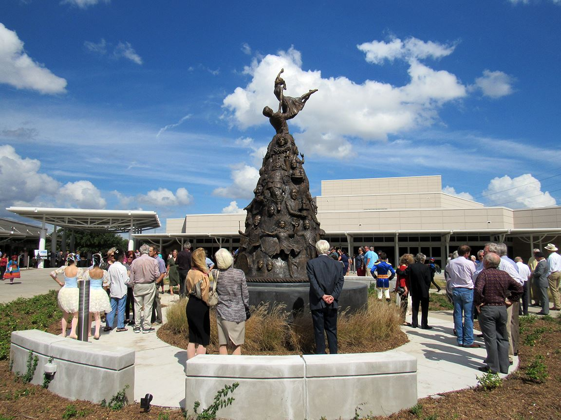 Crowd Viewing the Vision of the Arts Sculpture