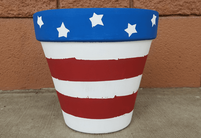 Picture of a Flower Pot painted with red and white stripes and blue stars
