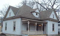 An old white house with a front porch.