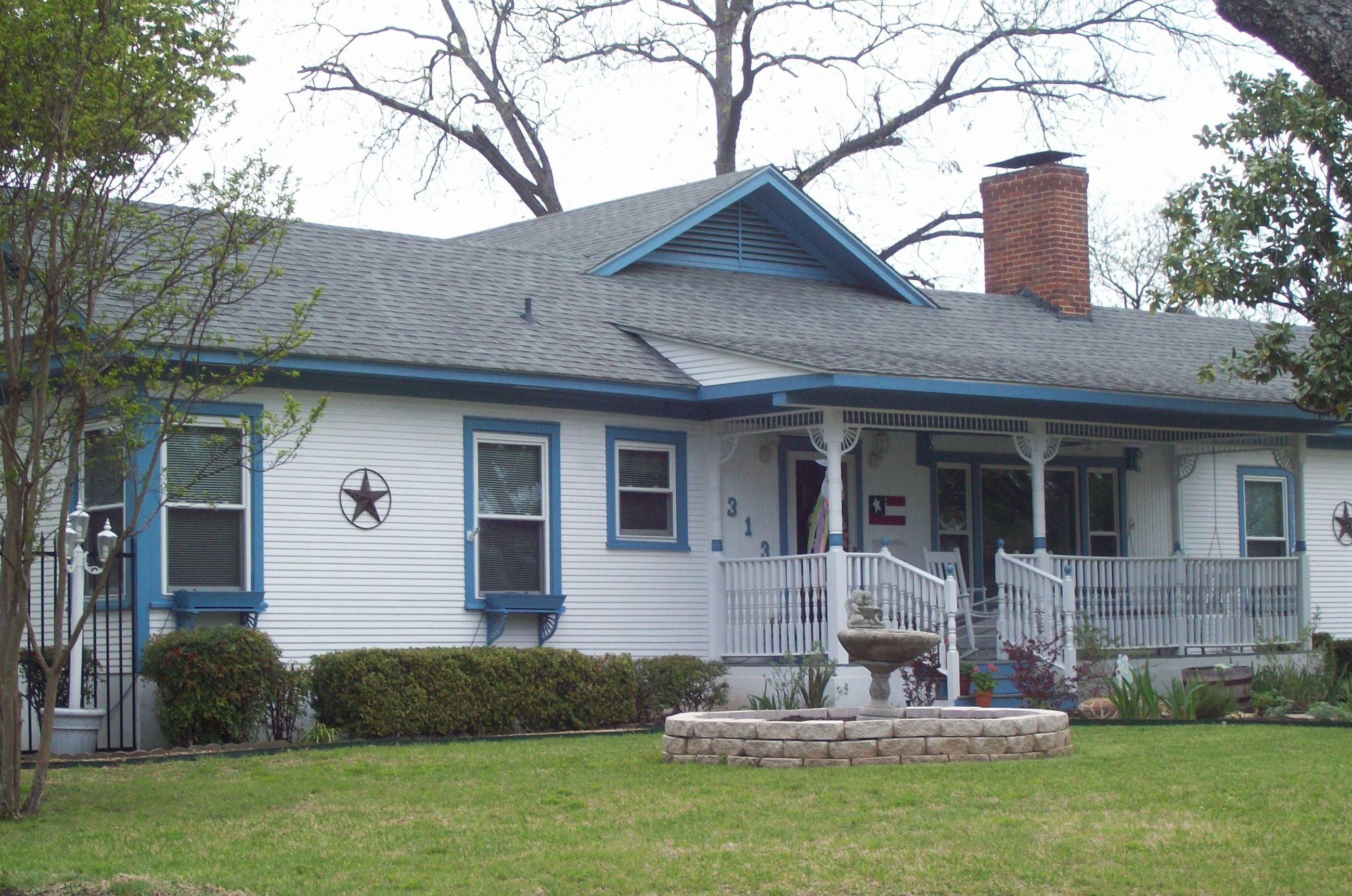 A white house with blue painted trim.